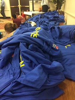 """Blue T-shirts that read """"It Ends Now"""" were given out at the event. Word has circulated that some students and alumni plan to wear those shirts, instead of red shirts, to Saturday's home football game. - JACKIE KRUSZEWSKI"""