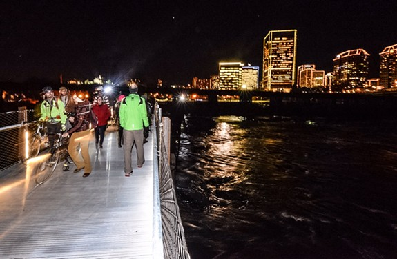 People venture across the new T. Tyler Potterfield Memorial Bridge, which opened Friday night during downtown's Grand Illumination. - SCOTT ELMQUIST