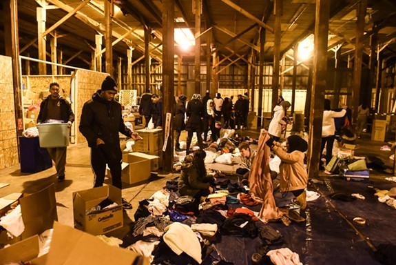 Volunteers, many of them VCU students, spend Friday night filling up a shipping container with medical supplies, clothes and other necessities bound for Syrian refugee camps. - SCOTT ELMQUIST