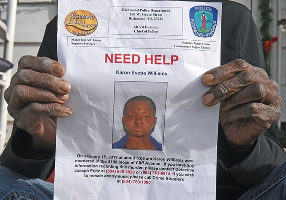 Holding a flier seeking help from police, Shirley Robinson remembers her friend Karon Williams as a kind, dependable neighbor. - SCOTT ELMQUIST