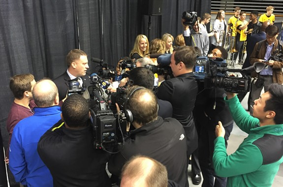 VCU's new head basketball coach, Mike Rhoades, is introduced to media and an enthusiastic crowd of fans at the Siegel Center on Wednesday morning. - F.T. REA
