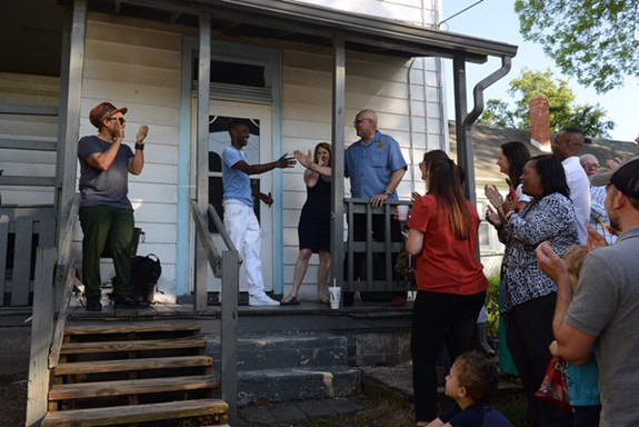 Speech, leader of the hip-hop group Arrested Development, (porch left) and Sheriff C.T. Woody (porch right) join in a performance by an alumni of the REAL program at the REAL house event on Tuesday. - SCOTT ELMQUIST