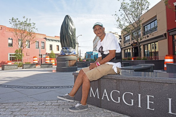 Melvin Jones Jr. sits in front of the Maggie Walker statue that he spent years advocating for. It's set to be unveiled Saturday, July 15, on Walker's 153rd birthday. - SCOTT ELMQUIST