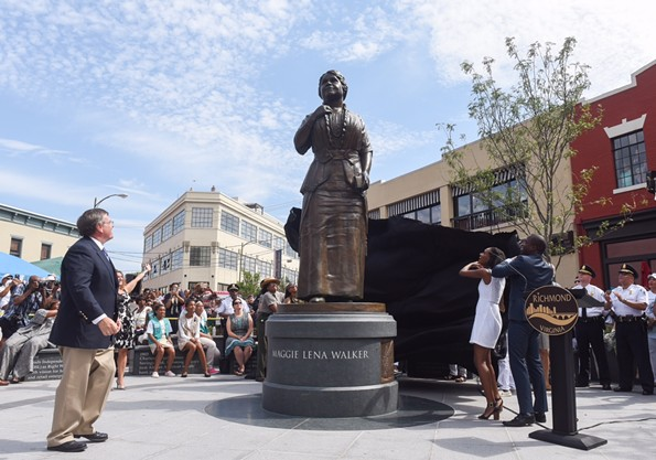 Sculptor Toby Mendez, left, watches Liza Mickens, the great-great granddaughter of Maggie Walker, and Mayor Levar Stoney pull a cover off the new statue to Walker. - SCOTT ELMQUIST
