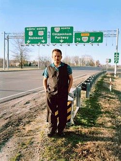 In a photo by Steven Casanova, Federico Xol stands near the spot where he first got off a bus in Richmond to meet his brother, following a perilous journey from Central America