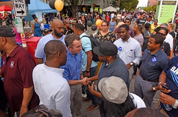 Northam greets voters in Jackson Ward on Oct. 7 at the Second Street Festival. - SCOTT ELMQUIST