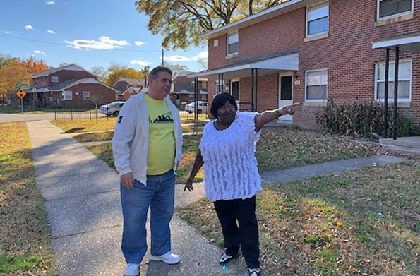Eric Samuelson, nonprofit co-founder, and Joanne Towles of Fairfield Court's tenant council are part of an effort to bring support programs to families in the public housing neighborhood. - PHOTO COURTESY ERIC SAMUELSON