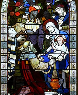 Wise men from the East are depicted presenting gifts to Jesus in this Emmanuel Episcopal Church Christmas window. - SCOTT ELMQUIST