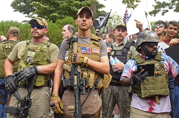 Sen. Barbara Favola, D-Arlington, is sponsoring a bill that would allow localities to prohibit the possession or transportation of firearms during protests, like this one in  Charlottesville, which descended into chaos. - SCOTT ELMQUIST