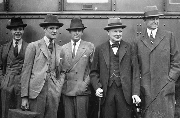 After being entertained lavishly in California, Winston Churchill's entourage made its way eastward. Posing at their train in Chicago are, from left, nephew John Churchill, son Randolph Churchill, Lord Feversham, a friend and advisor, the future prime minister, and Bernard Baruch, a prominent Wall Street banker, who helped plan the 1929 trip. - CHICAGO DAILY NEWS NEGATIVES COLLECTION, CHICAGO HISTORY MUSEUM