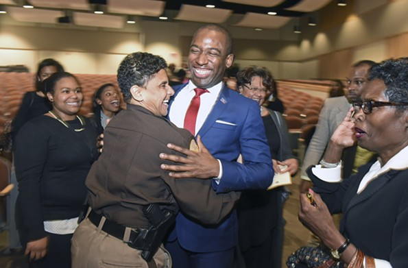 Irving hugs Richmond Mayor Levar Stoney after his State of the City address at Martin Luther King Jr. Middle School on Jan. 23. - SCOTT ELMQUIST