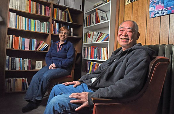 Gretchen Guinn and Chao-Kun Cheng take a moment to relax in Ekoji's library. They are both devoted members of Pure Land Buddhism. - SCOTT ELMQUIST