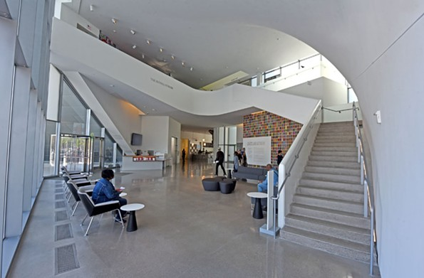 The Belvidere Street entrance leads to the forum and its dramatic staircase. - SCOTT ELMQUIST