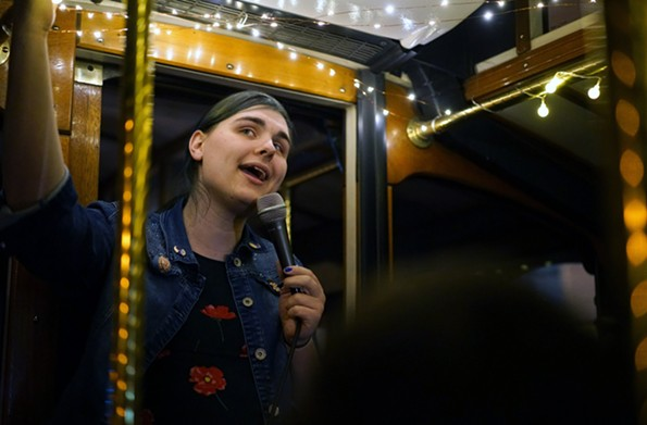 Comedian Mary Jane French performs aboard the laugh trolley. - LAUREN SERPA