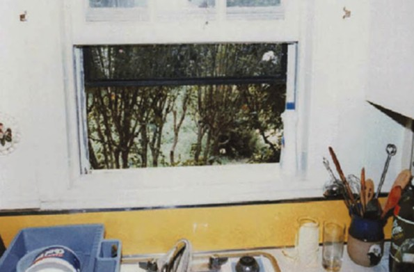 The South Side Strangler stole a rocking chair from a nearby porch and propped it up outside this kitchen window to gain entrance into Debbie Davis' apartment.