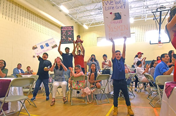 Family and friends of Yasmin Paredes cheer her on during the Miss Hispanidad talent show. - SCOTT ELMQUIST