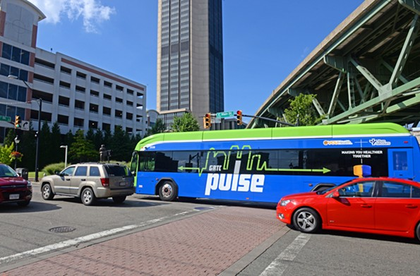 A bus leaving the Main Street Station stop rolls into heavy traffic in the 1400 block of East Main near a state parking deck and the Monroe Building. - SCOTT ELMQUIST