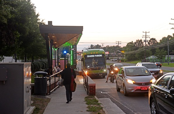 At Willow Lawn, a Pulse bus waits on motorists to clear a station before docking. Drivers and riders are adjusting to new street adjustments and traffic patterns. - SCOTT ELMQUIST