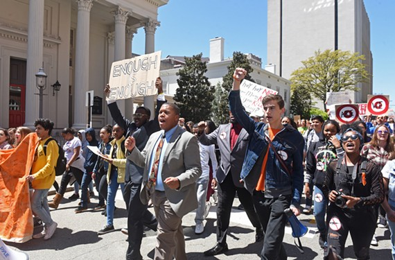 Ta'Quan Grant, a Thomas Jefferson High School senior and School Board candidate, marches during a gun violence protest in April.