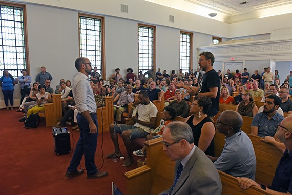 At a Wednesday evening meeting, Manchester residents express concerns about a homeless shelter proposed at the former Community Bainbridge Street Baptist Church.