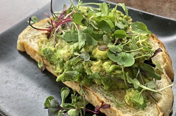 At the Daily Kitchen and Bar, microgreens and everything bagel seasoning join smashed avocado on a slice of sourdough from Flour Garden Bakery.
