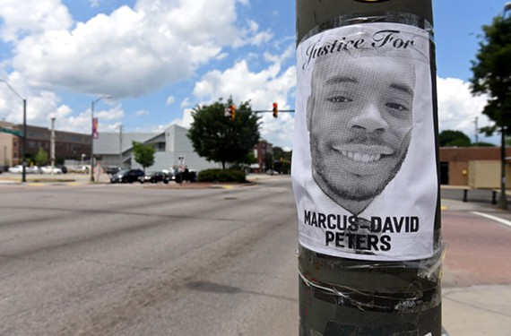 After the death of Marcus-David Peters, family members posted fliers near the site of the shooting.