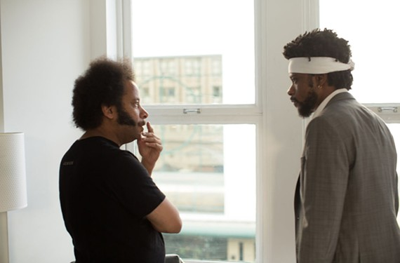"Director Boots Riley and actor Lakeith Stanfield on the set of ""Sorry to Bother You."""