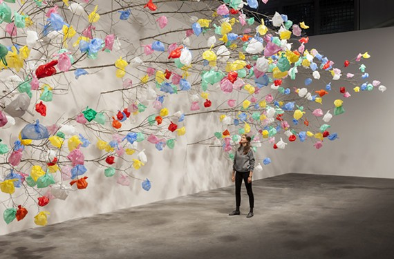 """Plastic Tree"" is a work by Pascale Marthine Tayou, a Cameroonian artist whose art raises questions about globalization and postcolonial culture."
