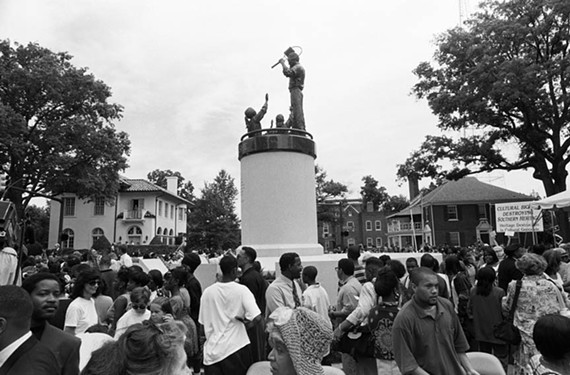 Supporters and protesters gather at the Arthur Ashe statue on July 10, 1996, at its unveiling on what would have been the tennis star's 53rd birthday. He died in 1993.