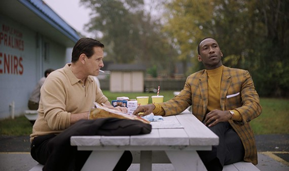 Viggo Mortensen as Tony Lip, getting poetic letter-writing tips from his boss, Don Shirley, played by Mahershala Ali.