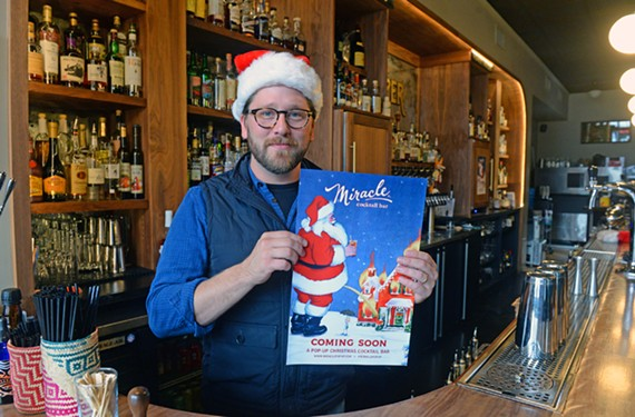 Mattias Hägglund, owner of the Jasper bar, holds a promotional flier for his pop-up Christmas cocktail bar.