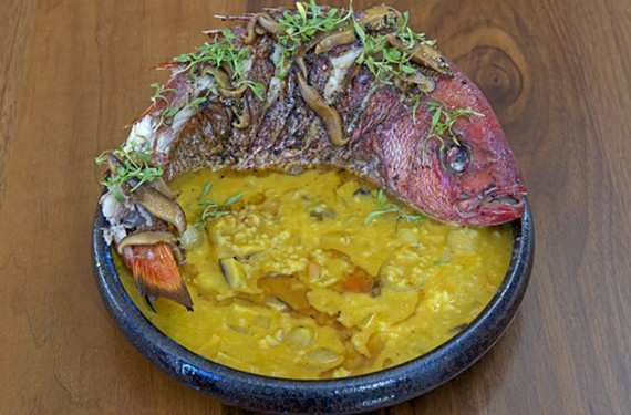 The whole roasted snapper at Alewife is served with sweet potato curry, rice and pickled shiitakes.