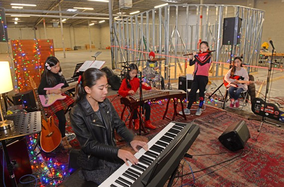"Red Flag, a group of middle school girls who play rock in mandarin Chinese, practice at Orbital Music Park, a new space that has been described as ""eHarmony for guitars."""