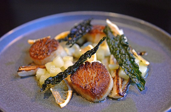 The day boat scallops are served with pureed parsnips, cubed potatoes, crispy kale and braised endive.