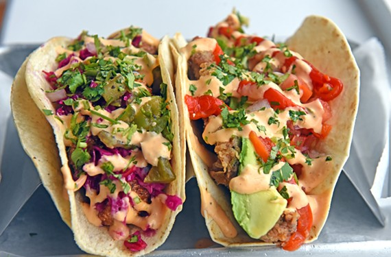 With fillings like chicken-fried carne asada, at left, and cornmeal-crusted catfish, Soul Taco serves classics with a twist.