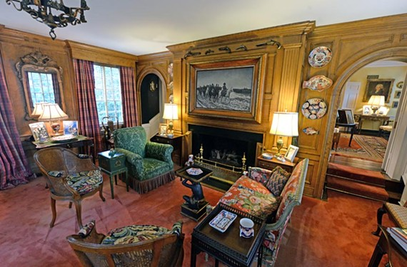 One of multiple living spaces in the brick mansion at 201 Virginia Ave., owners Robert Hines Jr., and his wife, Anne, this living room prominently features antiques from the 1700s and 1800s.