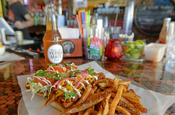 The vegan No Pambozos, piled with meat-free chorizo, dairy-free cheese, fried potatoes, pickled red onion, iceberg and tomato is served with a side of hand-cut fries. The White Label Yerba Mate soda comes from Brooklyn, New York.
