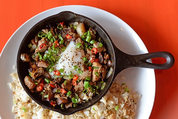 The pork sisig features crispy pig's head, onsen egg, Thai chilies and calamansi