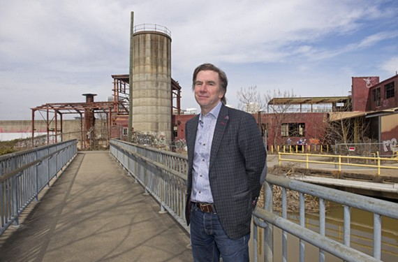 Architect Walter Parks is pictured at 111 Hull St., the site of a former paper mill, where South Falls, a 14-story, 255-unit apartment tower, will be built by developers WVS Co. and Fountainhead Properties.