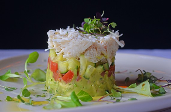 The crab stack small plate at the Tobacco Company features lump crabmeat on a base of mashed avocado, cucumber and tomato.