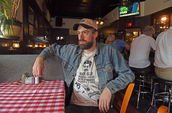 Singer and songwriter Benjamin Shepherd, shown sitting in Bamboo Café, was born in Nashville and moved to Richmond at 18. He'll have an album release show on Friday, May 10, at Capital Ale House's Richmond Music Hall.