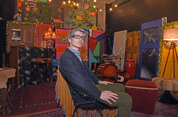 Justin Laughter, the easy-going, go-to attorney for local musicians' needs, sits in Orbital Music Park rehearsal space and instrument library. He's worked with bands including Gwar, Bio Ritmo, No BS Brass and Carbon Leaf.