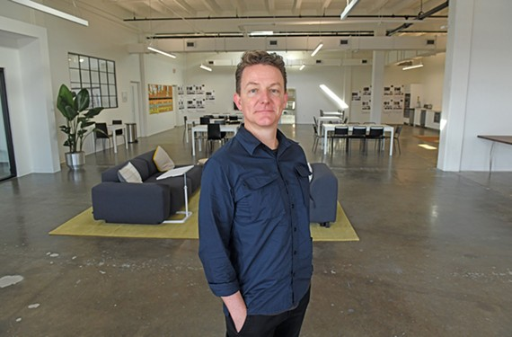 Chris Bossola, chief executive of Need Supply, says that his company's merger with Totokaelo, a luxury retailer from Seattle, will help increase its scale with e-commerce.