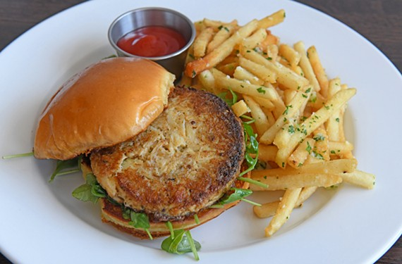 The crabcake sandwich at Saltbox Oyster Co. comes on a brioche roll with a side of garlic-Parmesan fries.