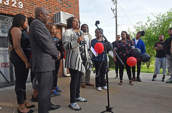 Sayyeda Hall speaks at a vigil held for her son, Malik Banks, who was shot and killed April 13.