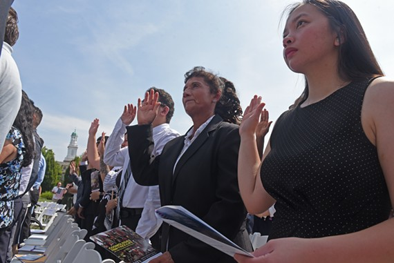 Nearly 100 people became citizens during a July 4 naturalization ceremony at the Virginia Museum of History and Culture.