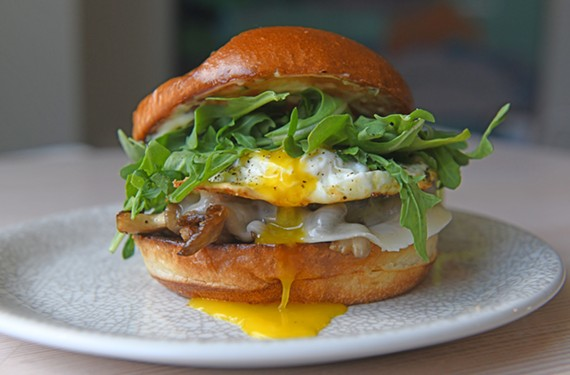 This breakfast sandwich at Chairlift features wild mushroom, a sunny-side-up egg, arugula, herb aioli and provolone on a brioche bun.