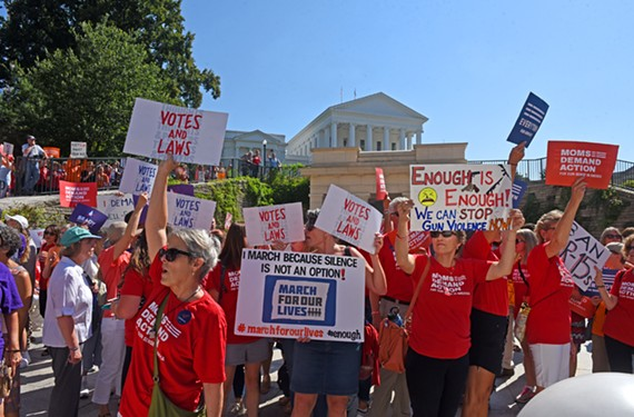 """Members of Moms Demand Action protest at the entrance to the state Capitol on Tuesday, July 9, before the General Assembly special session on gun control. Among the chants: """"You vote today, we vote in November."""""""