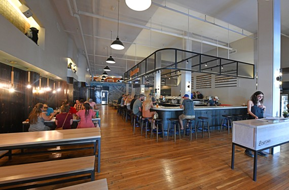 Dogtown Brewing Co., owned by developer Laura Hild, opened its doors in Manchester last week.