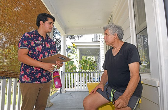 Fifth District City Council candidate Nicholas Da Silva talks to prospective voter Chris Walsh while canvassing Randolph on Saturday, Aug. 17.